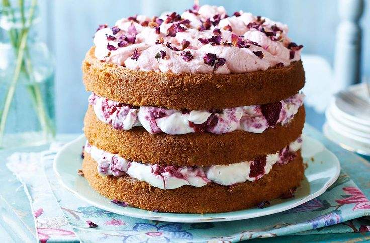 Fancy and flavoursome, this cake – with pretty pink petals, sweet raspberries and cream – is perfect for a special occasion.