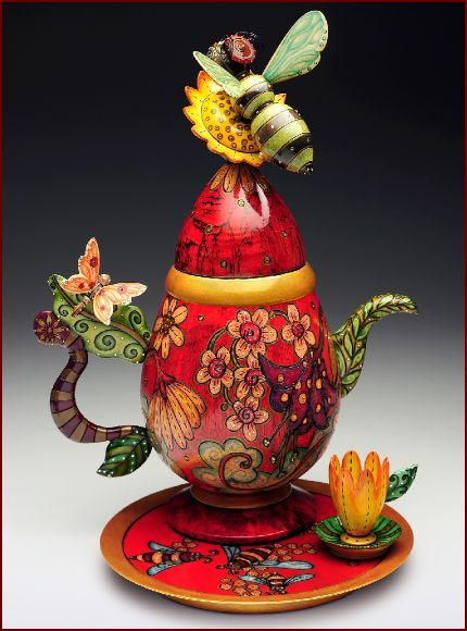 Unique Artisan Teapot Quirky/Whimsical Design - Flowers/Garden adorn the pot body w' A Bee atop a Sunflower on the Lid, while a Butterfly is resting on the Handle & the Tea -pot sits on a matching plate w' a Flower mini Cup (I think?) via 'tumblr.com' - Fab Fun♥♡♥