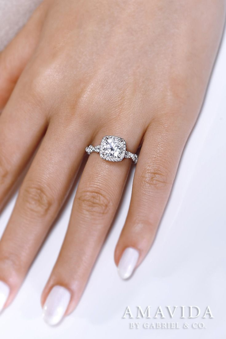 Gabriel - Beautiful 18k white gold round cut halo engagement ring. This simple round engagement ring has a beautiful halo surrounding it along with over half a diamond on the sides. Find more here ->