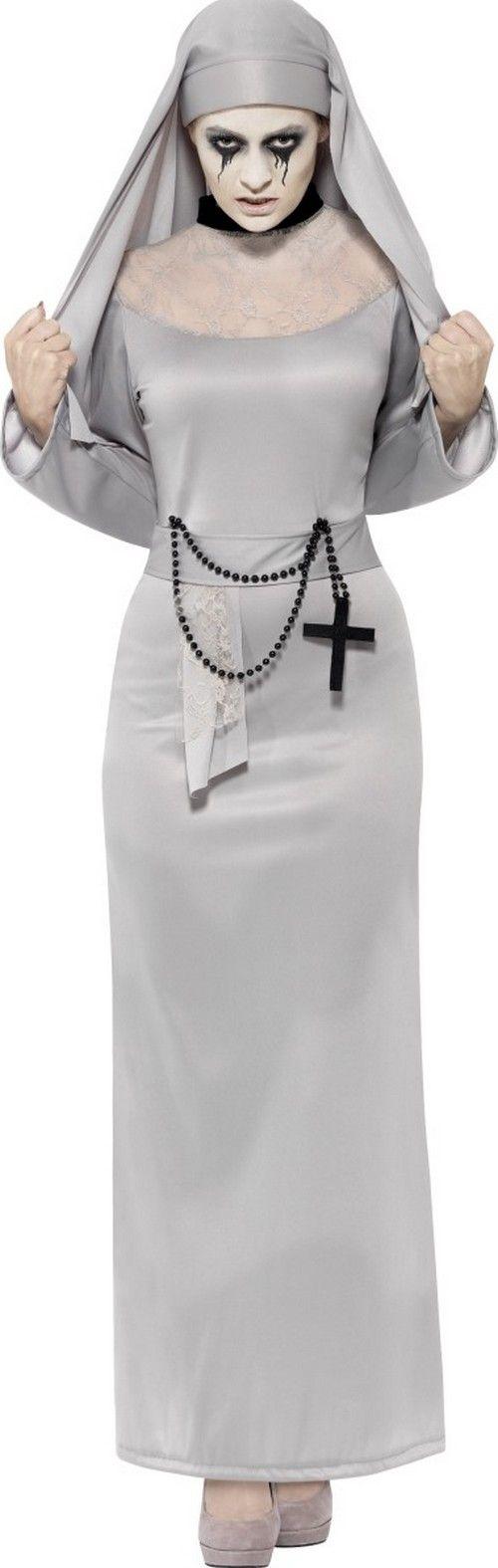 Déguisement fantôme religieuse femme Halloween : Ce déguisement de fantôme de religieuse pour femme se compose d'une robe et d'une coiffe (chaussures non incluses). La robe longue est grise, avec une fausse ceinture cousue sur...