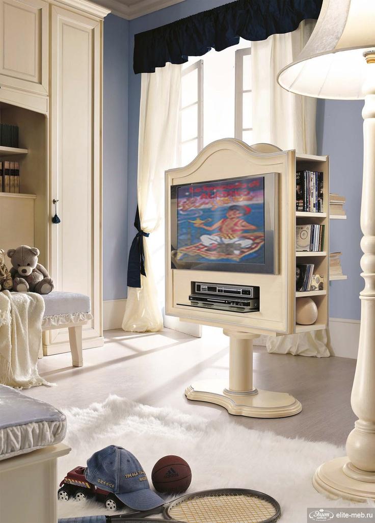 Подставка для аппаратуры от итальянского производителя РМ 4. Многофункциональный модуль включает в себя: подставку под телевизор, полки для хранения книг, дисков и полку для DVD аппаратуры. Отделка - бежевый цвет с эффектом ручного нанесения. Стиль классический.