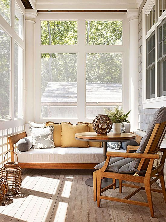 Daybed Dreams  Organic textures -- whether the couch and chair fabric or the woven candle lanterns -- lend a beachy feel to this screen porch. Columns and windows with obvious woodwork make this porch feel more like an extension of the home than a separate outdoor space. Incorporate a daybed on a porch, like the teak one on this porch, which works as a sofa for group gatherings or a sleeping perch for solitary afternoons.