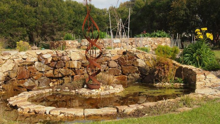 Dry stone wall leading to pond designed and constructed by Abben Art Garden Design