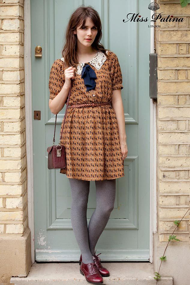 print dress, grey tights and brogues.