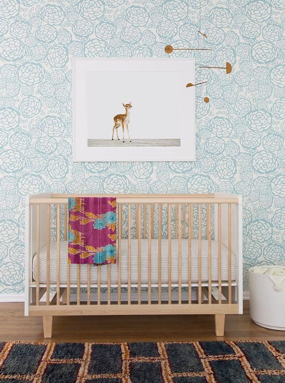 Pretty teal floral wallpaper, geometric mobile, deer art - a nursery I want to live in !!