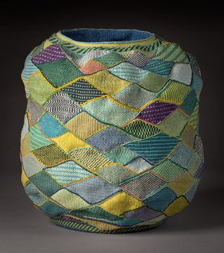 Another one of Lois Russell's moving basket made from waxed linen twining