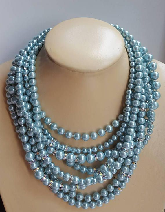 Check out this item in my Etsy shop https://www.etsy.com/ca/listing/547054839/blue-chunky-pearl-choker-with
