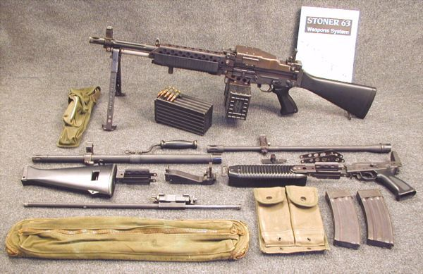 Stoner 63A weapon in Commando light machine gun configuration, same as US S.E.A.L. Mark 23 Model 0 gun. Weapon is shown with complete set of subassemblies and barrels, necessary to convert to other configurations, such as magazine-fed light machine gun or assault rifle.
