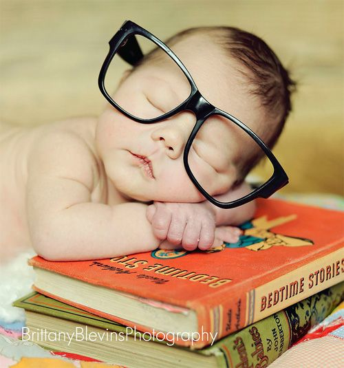 bedtime stories. Love big glasses!