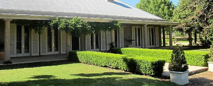 beautiful homestead with shutters & french doors