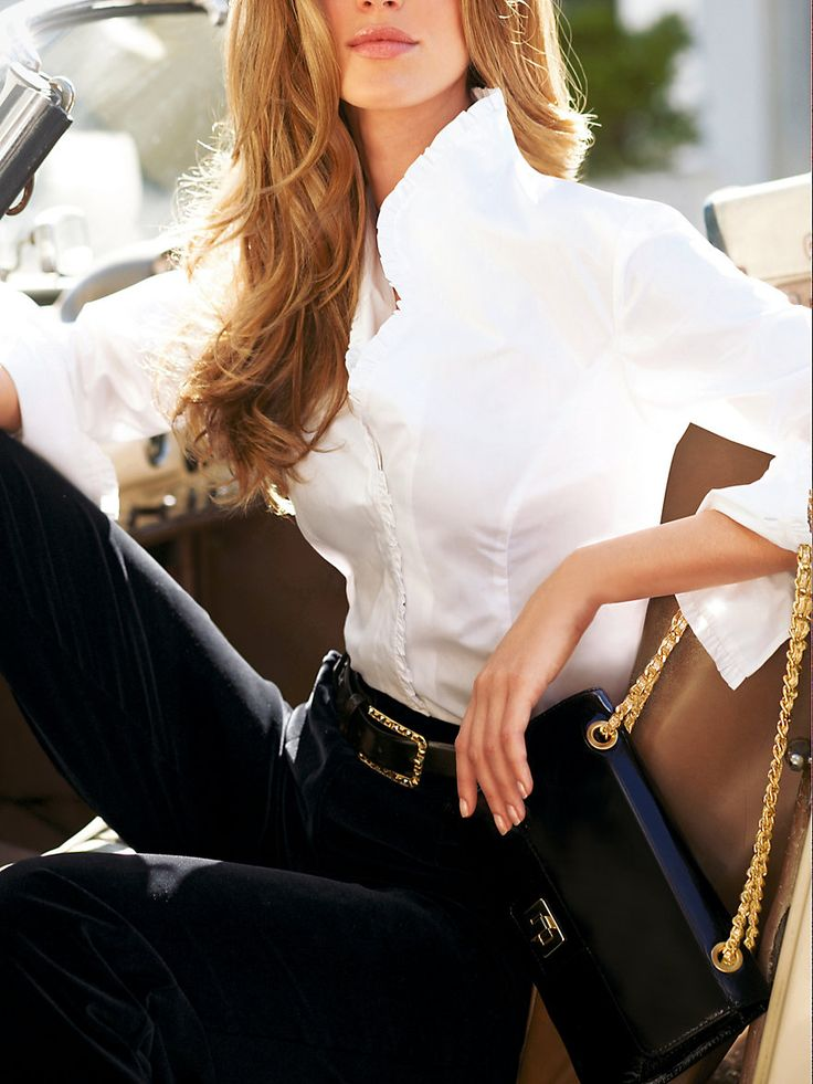My personal favorite for men and women a crisp starched white button down blouse/shirt.