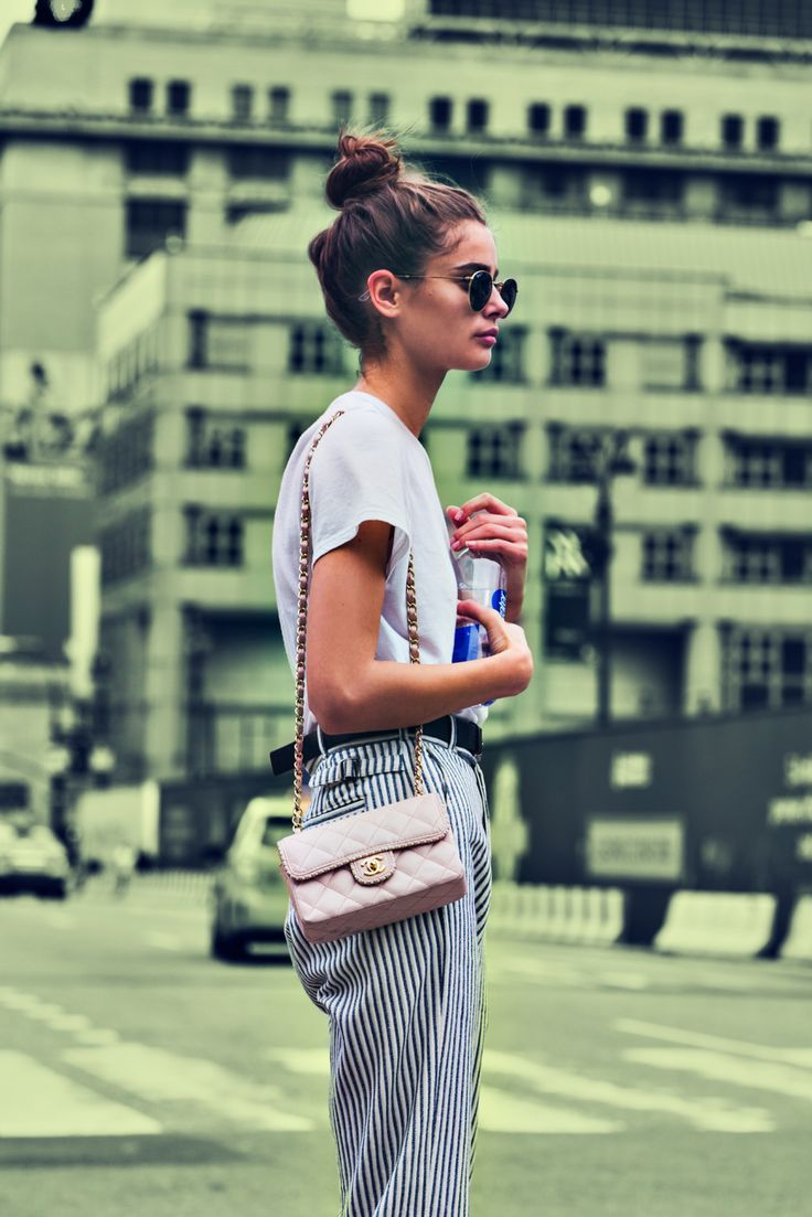 Messy bun, street scene, badass handbag, sunnies - this is gorgeous - shes about to change the world.  Or get a coffee.  Or just hang out looking fab.  Smart casual wild pretty - I like that