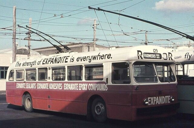 ARA Trolley Bus No129 City Depot Auckland, 1974. Bus in all over advertising scheme. Image via flickr