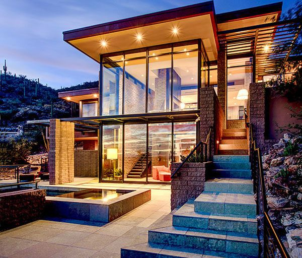Multi-level desert home organically forms into the mountainside