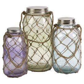 """Add a nautical touch to your decor with these charming netted jars.   Product: Small, medium, and large jarConstruction Material: Glass, iron and juteColor: Purple, green, blue and naturalFeatures: Pastel hues and coastal inspired jute nettingDimensions: Small: 9.5"""" H x 5.5"""" Diameter Medium: 11"""" H x 5.75"""" Diameter Large: 12.75"""" H x 6.75"""" Diameter"""