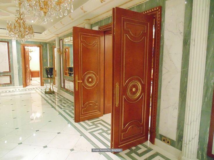 Lot 1243 - A pair of mahogany internal panel doors each door 705mm x 2300mm x 80mm