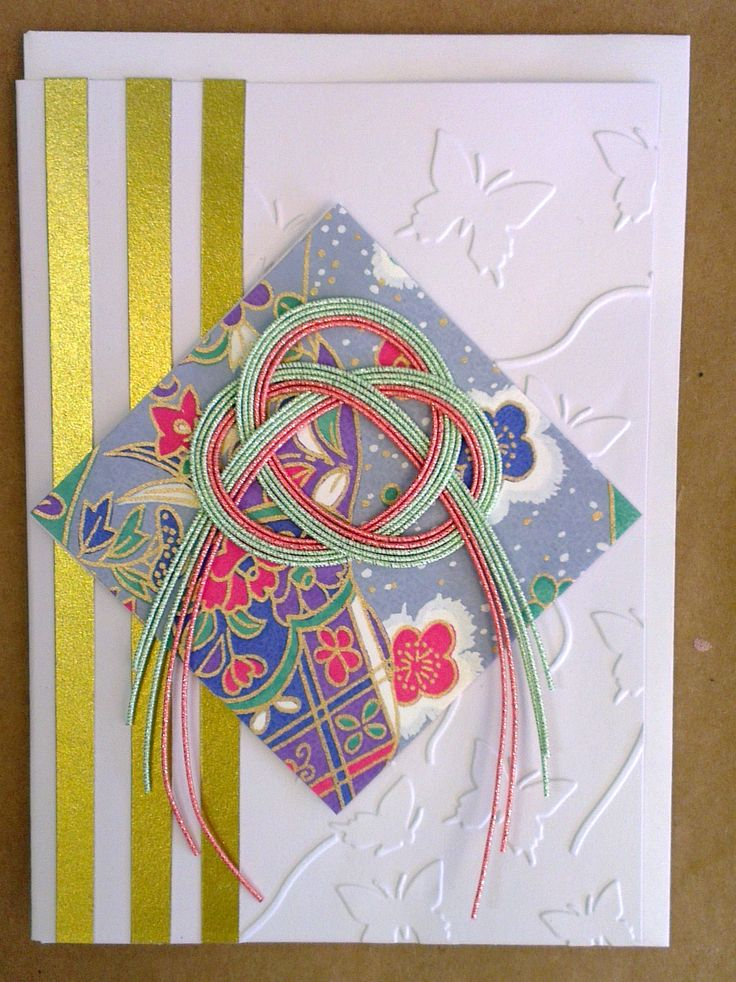 handcrafted greeting card featuring a mizuhiki knot, Japanese origami paper and embossed background.