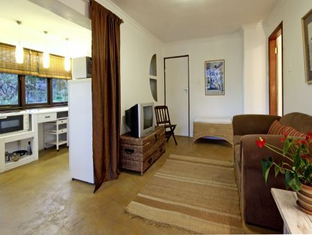 Self catering accommodation, Clovelly, Cape Town, South Africa  Lounge and kitchen of the Clovelly Lodge Apartment.