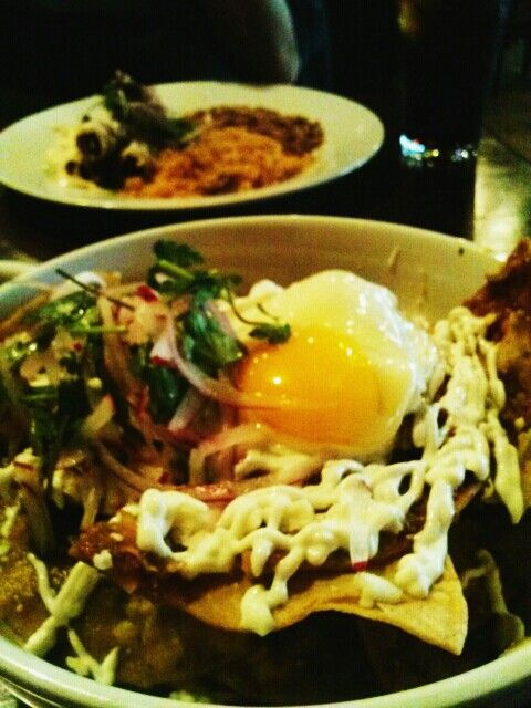 Chilaquiles with a fried egg over easy at #amorytacos in Cerritos