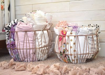Don't hide cute sheets and blankets, display them in baskets! Hello Baby Brown: Phayre's Nursery Tour