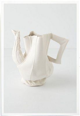 israeli artist and designer rachel boxnboim: process-oriented sculptures out of clay. In her 'alice' series, boxnboim begins by sewing a soft mold, the first of which was inspired by her mother's old teapot. she then fills it with liquid porcelain, allowing it to stick to the walls of the mold, and pours out the excess. during the kiln-firing process, the fabric burns away, leaving a thin cloth-like layer of clay, imprinted with the texture of the original mold.