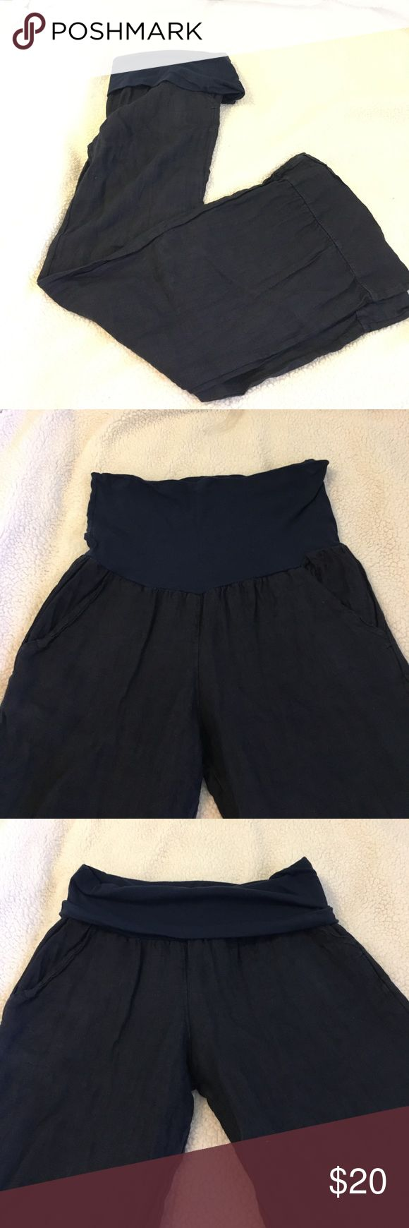 Authentic Italian linen pants I bought these in a small market while living in Italy. Unfortunately, I was only able to wear a few times and they no longer fit. They are a dark navy blue color and 100% linen. There is a high, adjustable waistband (see images). The pant is a boot cut and is wide on the bottom. The size is European small. So amazing for travel. Pants