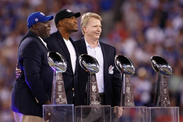 Ex-New York Giants Phil Simms, right, Michael Strahan, center, and Otis Anderson stand next to four Vince Lombardi trophy during a ceremony before the NFL football game between the Dallas Cowboys and the New York Giants Wednesday, Sept. 5, 2012.Vince Lombardi, Football Giants, Vince Lombardy, Football Games, Bowls Trophy, Dallas Cowboy, Ny Giants, New York Giants Phil Simms, Michael Strahan