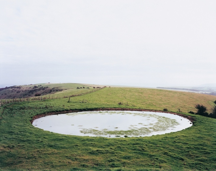 """Dew pond, Ditchling Beacon, Sussex. Jem Southam. """"I passed dew ponds and tumuli, twin symbols of the downs; concave and convex, each the formal inverse of the other"""" Robert Macfarlane. From The Essay: A Five-Day Journey"""