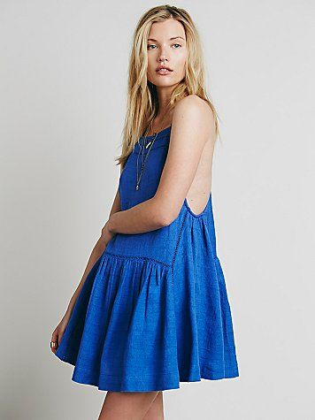 Skipping Stones Dress | Drop waist linen mini dress featuring embroidery trim and a full skirt.  Racerback detailing.  Lined.