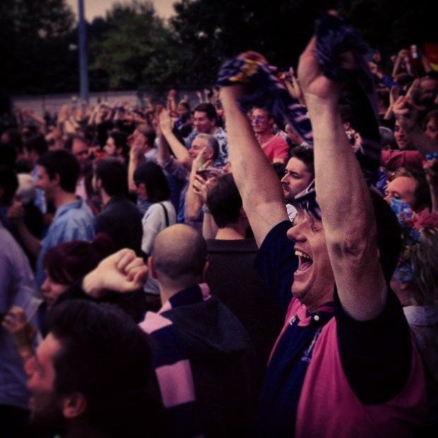 Fans celebrate as Dulwich Hamlet take the league in their Non League Day match with Hampton and Richmond Borough