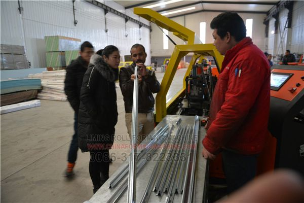 #High #Quality #Light #Keel #Roll #Forming #Machine is our update roll forming machine,it is Euro Quality.We update all parts of this machine,so it is have good quality and long working life. Dubai customer testing roll forming machines in workhouse.