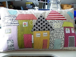 appliqued little houses - great fabrics! Want this!!! I have an obsession with collecting house things.