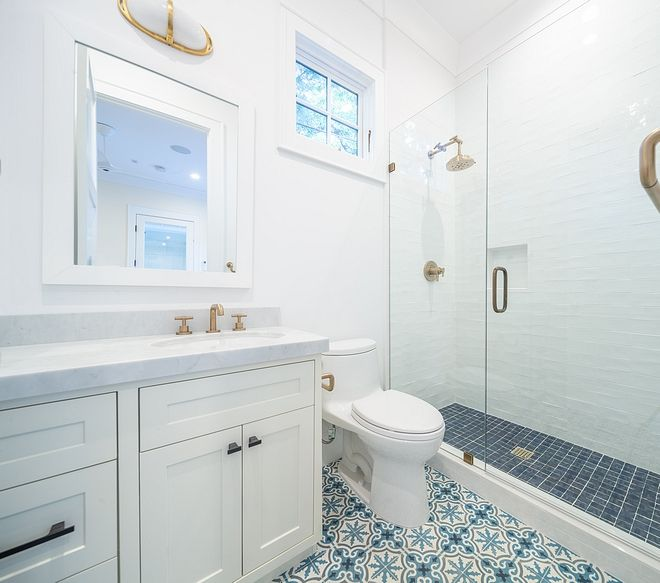 blue and white cement tile bathroom