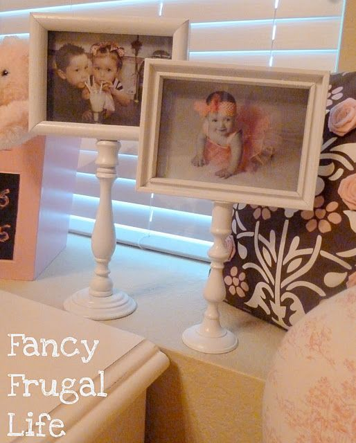DIY pedastal picture frames. Made from two candle stick holders and pic frames, all purchased from Good Will for a total of $4. Spray paint white, glue together, and ta-da! Very cute, inexpensive, and she gives you step by step instructions.