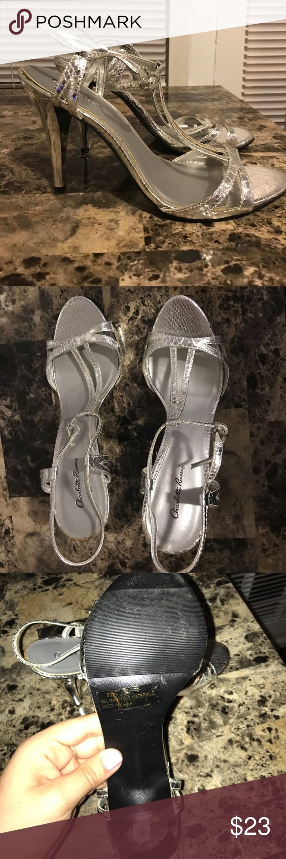 Charlottes Russe heels Silver Charlotte Russe heels. Never been worn! The lining of the heel part is starting to lift a little just from sitting in a closet for so long. In good condition! Charlotte Russe Shoes Heels