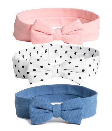 Light pink. Jersey hairbands with a decorative bow at front.