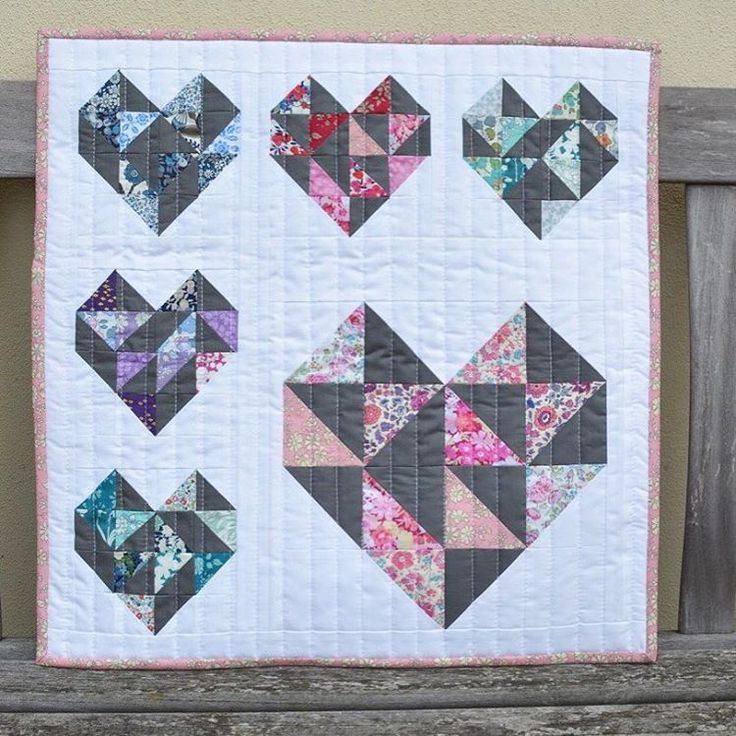 "It's a gloomy day here today, but these hearts are making me smile. The dimensions aren't the same as the instructions in Quilt Petite because I was using up my fox ear trimmings from my Liberty Fancy Fox quilt - so each HST in the little heart is 1 1/4"" finished.  It's very satisfying to have used all my tiny triangles rather than binning them. #quiltpetitesal #quiltpetite #libertyoflondon #agfpureelements"