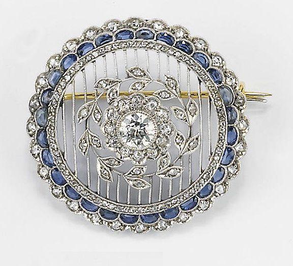 A DIAMOND AND SAPPHIRE PENDANT BROOCH, BY JANESICH, circa 1910-1920