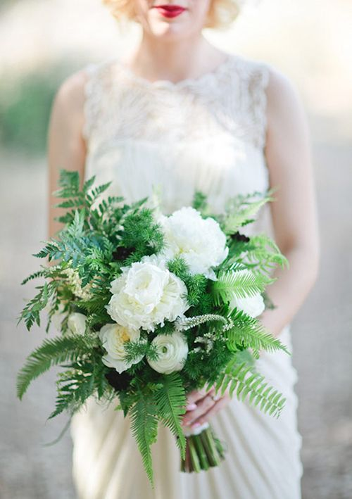 An emerald and white-toned #bouquet with ferns   Brides.com