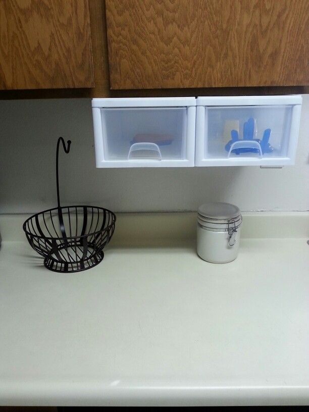 Running out of kitchen space? Attach plastic drawers to the underside of your cabinets and store the smaller stuff. In my case, baby bottles, cups, and bowls. (A fruit basket with attached banana hanger is a major plus too! And clearly I need groceries!) :-)