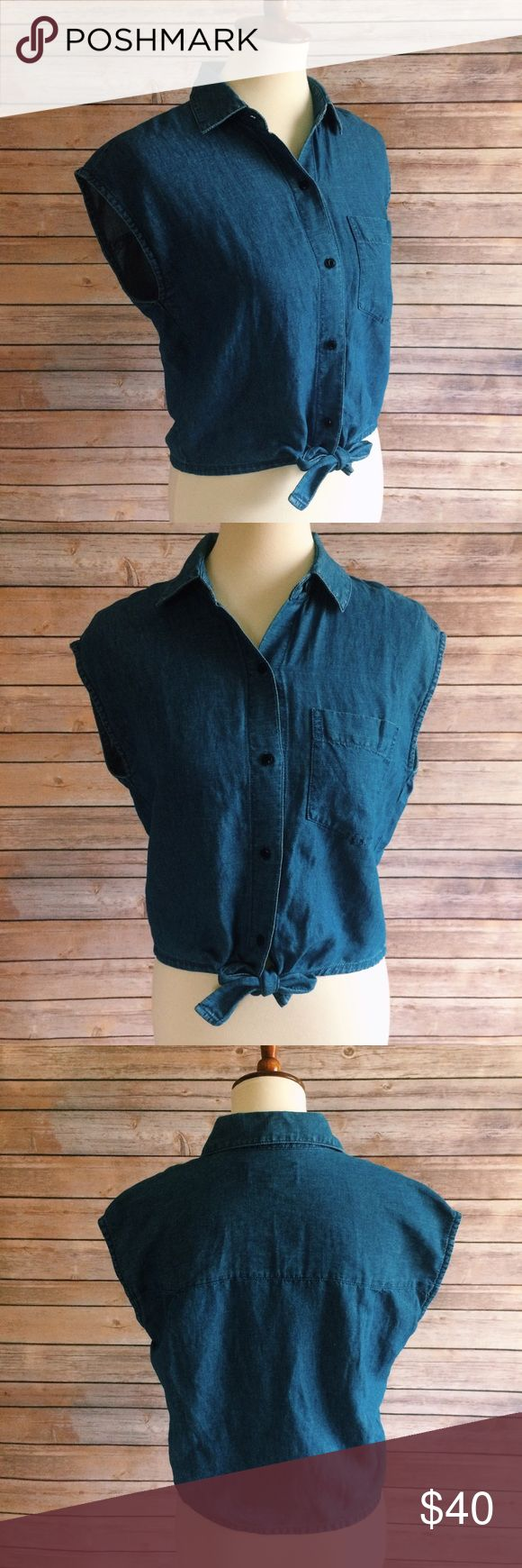Madewell Denim Sleeveless Tie-Front Top A sleeveless denim shirt with a flattering tie at the waist. So perfect with any and all high risers. Only worn once!   Cropped fit. Cotton/linen. Madewell Tops Crop Tops