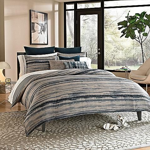 Bring style and sharp color to your bedroom with this tie dyed printed comforter from Kenneth Cole Reaction Home.
