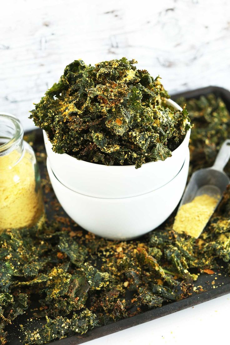 Easy, 30-minute baked kale chips with a cheesy, crispy coating! A healthy, nutrient-rich snack that's entirely plant-based.