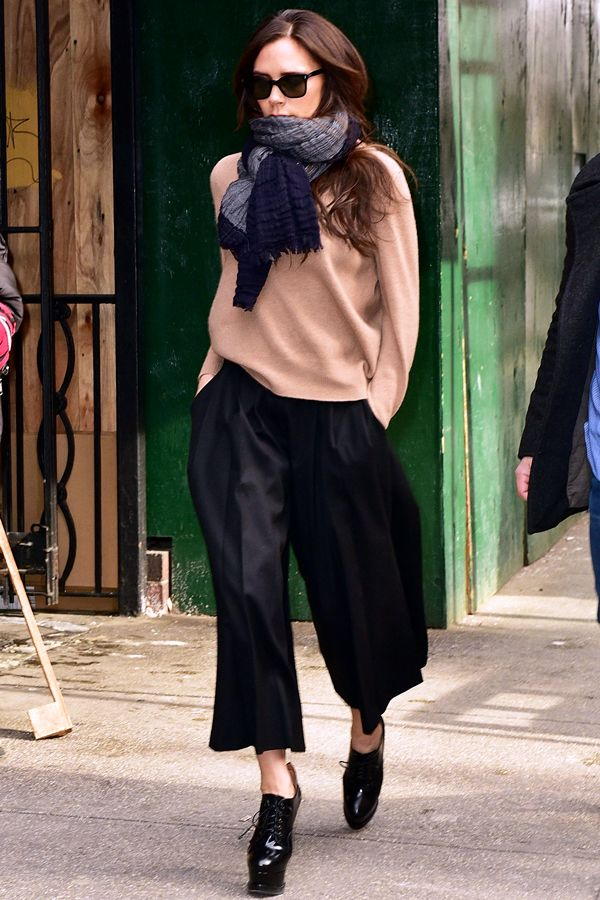 Victoria Beckham was photographed heading into Milk Studios in Chelsea wearing a tan sweater, black culottes, and Alaïa platforms.