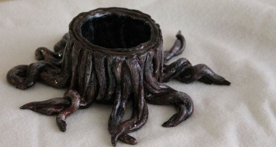 Hey, this one of my pieces http://www.etsy.com/listing/164865305/tree-stump-ring-or-small-jewellery