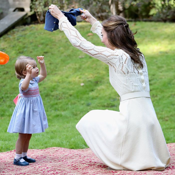 The royal tot received a little help from mom Kate, removing her cardigan.