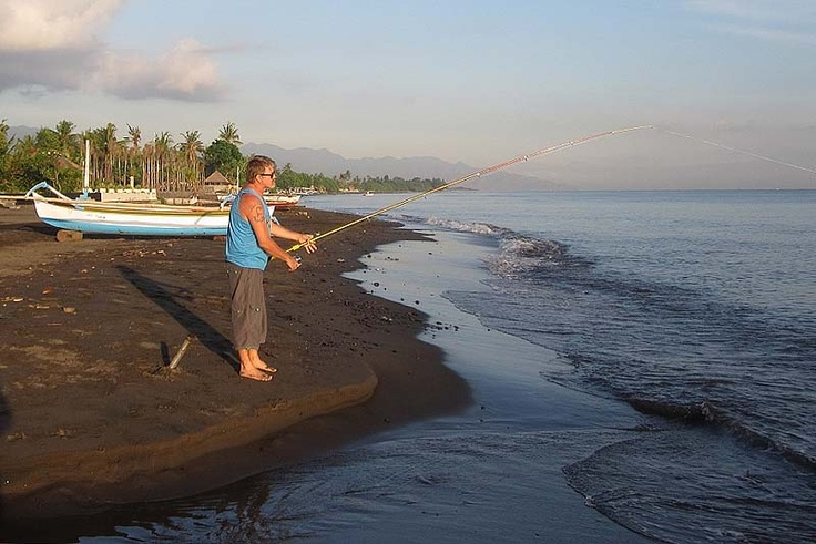 Fishing from the beach in front of villa Lovina-beach