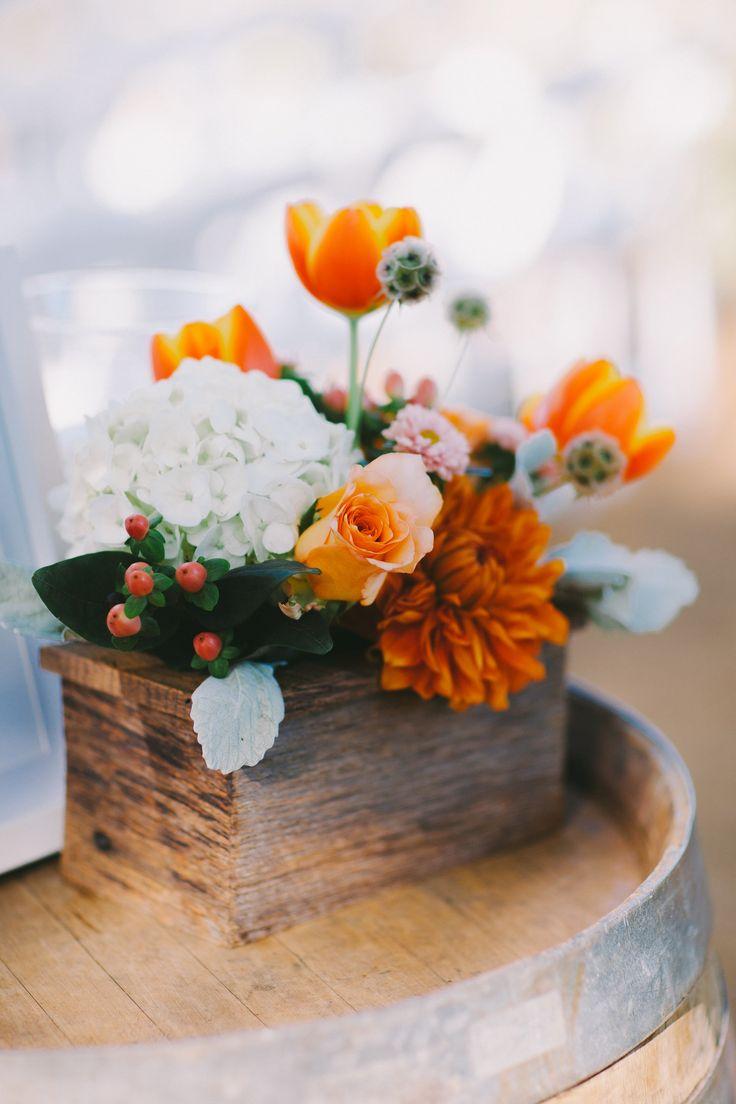 orange infused wedding florals Photography: Wildflowers Photography - wildflowersphotos.com  Read More: http://www.stylemepretty.com/california-weddings/2014/05/12/open-air-winery-wedding-in-healdsburg-california/