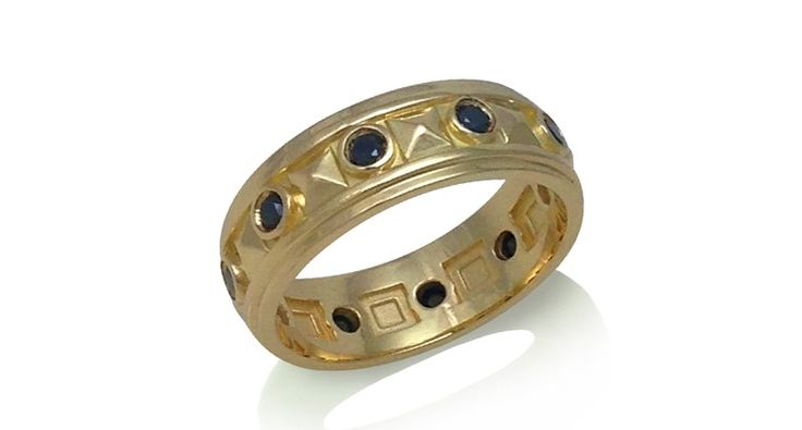 K. Mita Pyramid band ring from the Element Collection in 18-karat yellow gold with black diamonds ($2,800)