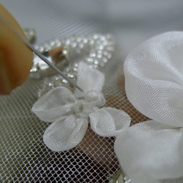 Silk flowers in the making |#handembroidery #micro #closeup #process #applique on #tulle #bridal and #fashion #artisan #craftsmanship #handmade #embroidery #design #wip #artisanal #heirloom #style #trueluxury #luxury #ethicallymade